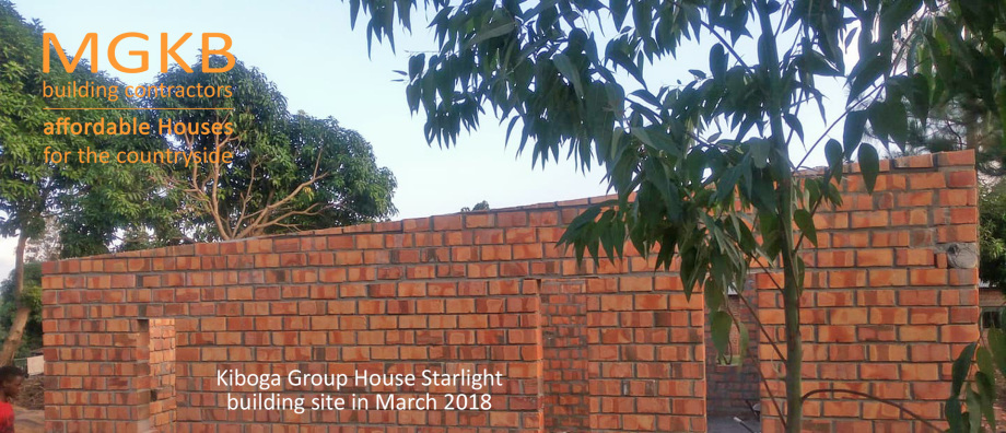 Brick work by young MGKB builders team on a site with no water and electricity - a countryside building site near Kiboga Uganda