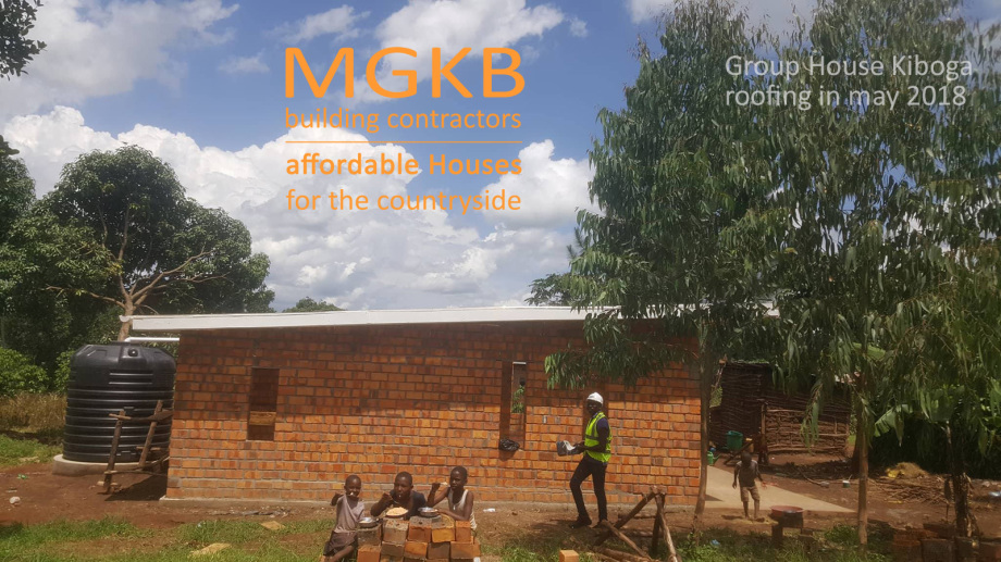 MGKB Group House Building Kiboga with a roof on in May 2018